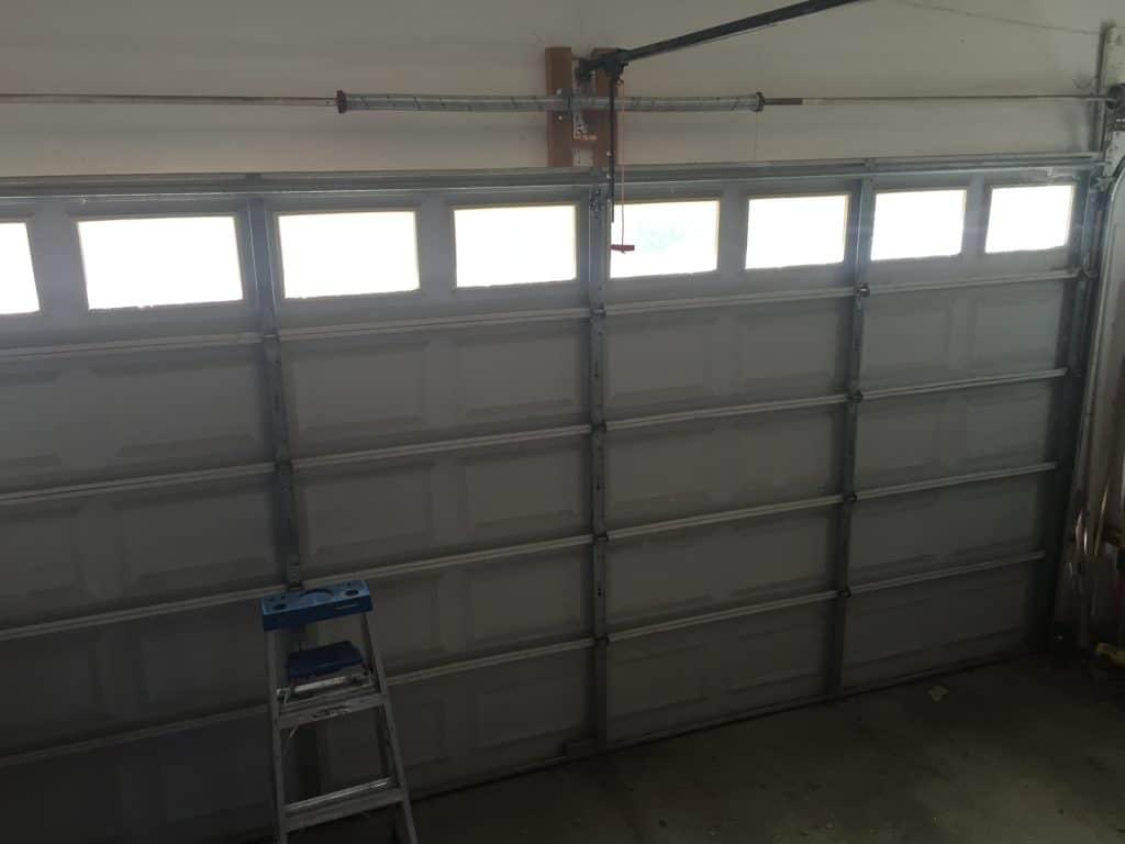 Spring repair, opener repair, garage door repair
